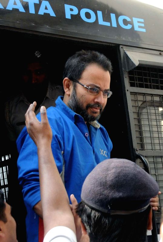 Suspended Trinamool Congress MP Kunal Ghosh being taken to be produced at a Kolkata Court in connection with multi-crore-rupee Saradha chit fund scam on Nov 27, 2014.