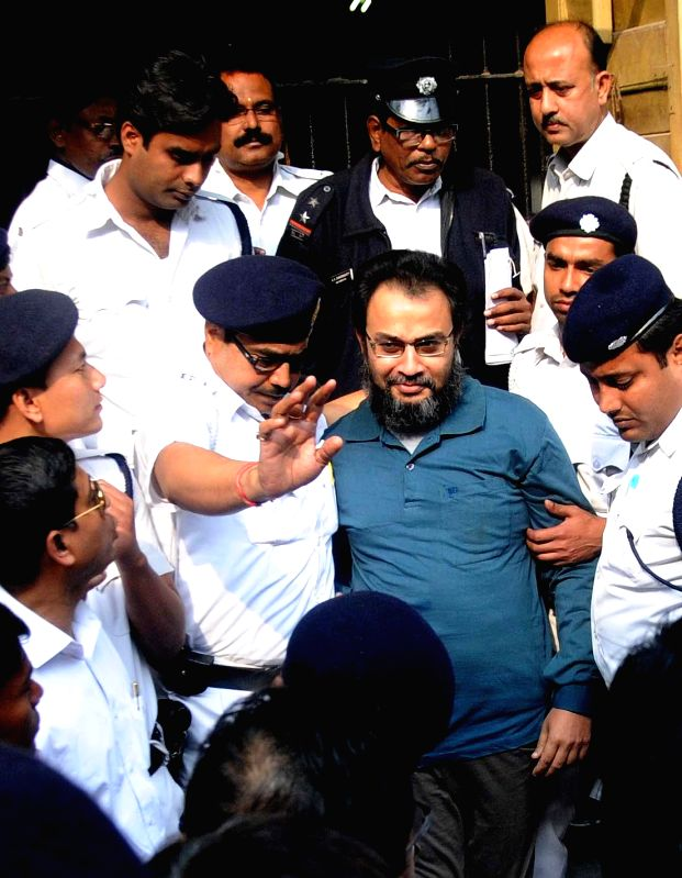 Suspended Trinamool Congress MP Kunal Ghosh being taken to be produced at a Kolkata Court in connection with the multi-crore-rupee Saradha chit fund scam  on Feb 10, 2015.