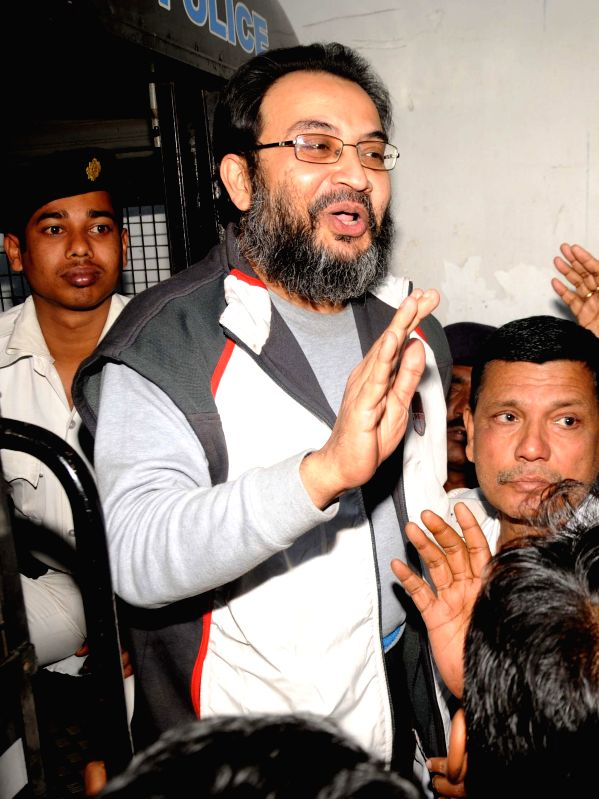 Suspended Trinamool Congress MP Kunal Ghosh being taken to be produced at a Kolkata Court in connection with the multi-crore-rupee Saradha chit fund scam  on Feb 11, 2015.