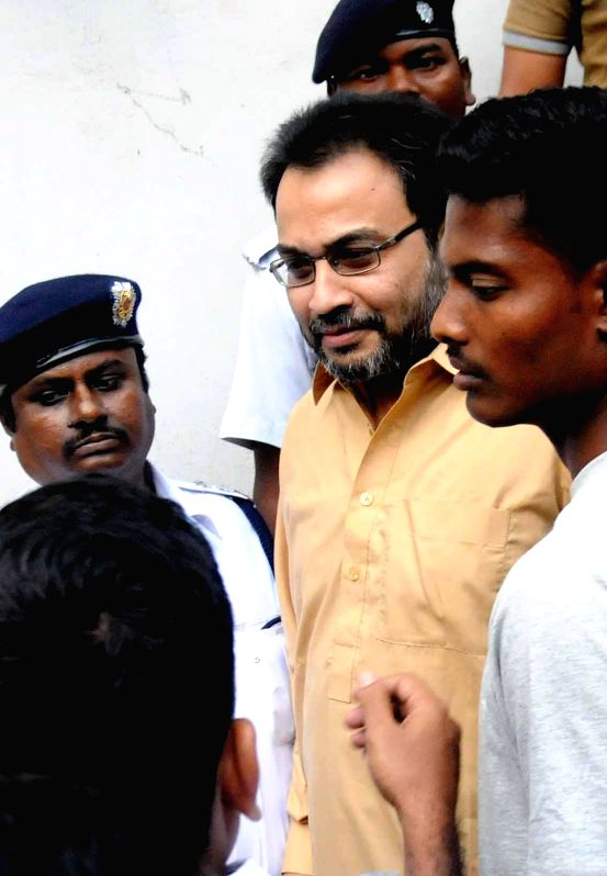 Suspended Trinamool Congress MP Kunal Ghosh being taken to be produced at a Kolkata Court in connection with multi-crore-rupee Saradha chit fund scam on March 13, 2015.