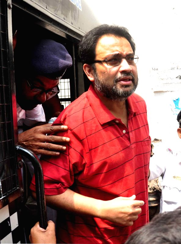 Suspended Trinamool Congress MP Kunal Ghosh being taken to be produced at a Kolkata Court in connection with multi-crore-rupee Saradha chit fund scam on April 6, 2015.
