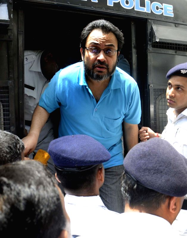 Suspended Trinamool Congress MP Kunal Ghosh being taken to be produced at a Kolkata Court in connection with multi-crore-rupee Saradha chit fund scam in Kolkata, on April 20, 2015.
