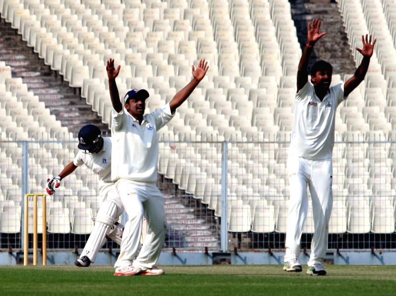 Tamil Nadu players celebrate after fall of a wicket during a Ranji Trophy match against Bengal in Kolkata, on Jan 6, 2015.