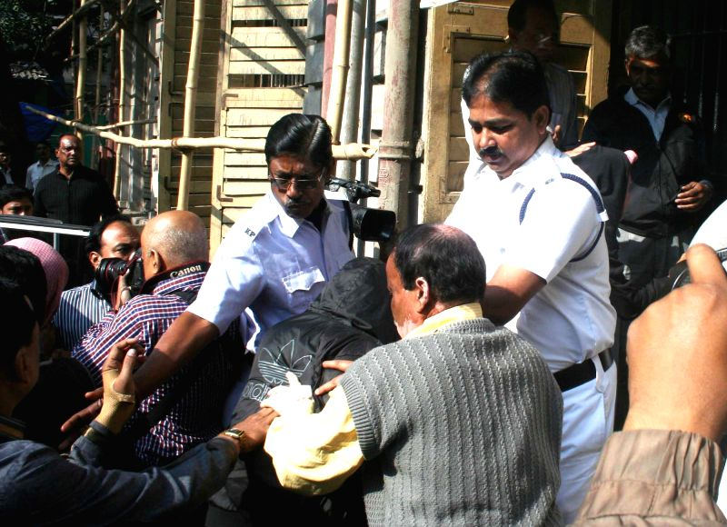 The accused arrested in connection with gangrape of a Japanese student being taken to be produced in a court in Kolkata on Jan 6, 2014.