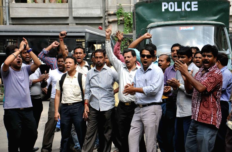 The employees of the Rose Valley Group stage a demonstration in front of Bidhannagar East police station to press for the release of group's chairman Gautam Kundu, who was arrested by the ED ...