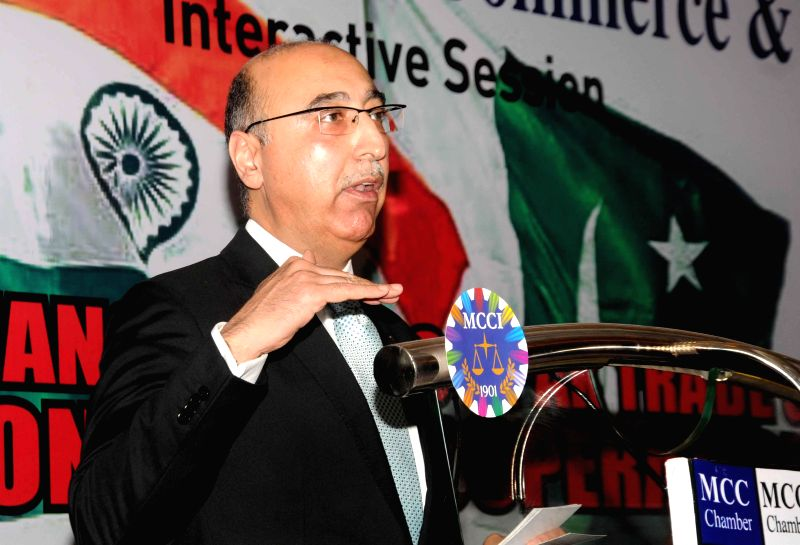 The High Commissioner of Pakistan in India, Abdul Basit addresses during an interactive session on `Enhancing Indo-Pak Trade and Economic Cooperation` in Kolkata, on March 18, 2015.