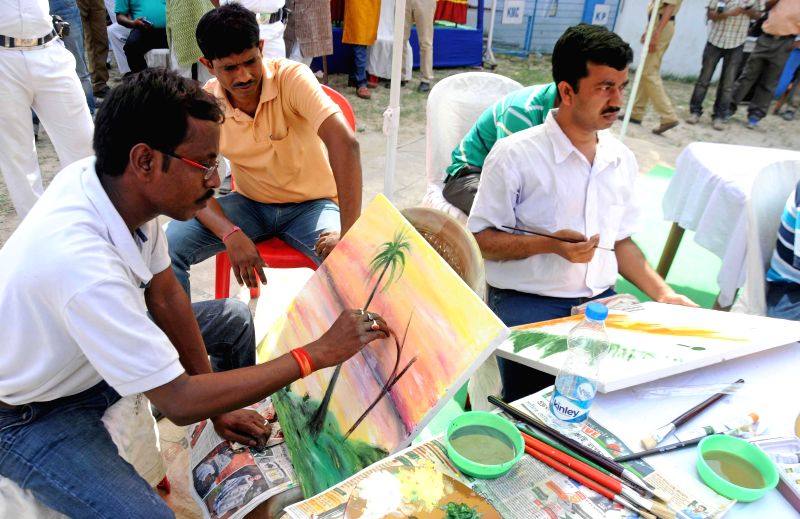 The inmates of Alipore Jail during an art exhibition in Kolkata, on March 1, 2015.