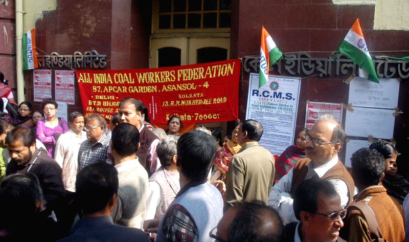 The members of All India Coal Workers' Federation stage a protest to press for their demands in front of Coal India office in Kolkata, on Jan 6, 2015.