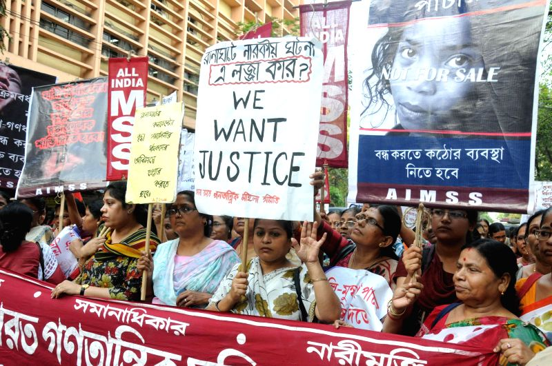 The members of CPI(M) women wing stage a demonstration against the recent gang-rape of a nun in Ranaghat of West Bengal`s Nadia district, in Kolkata on March 18, 2015.