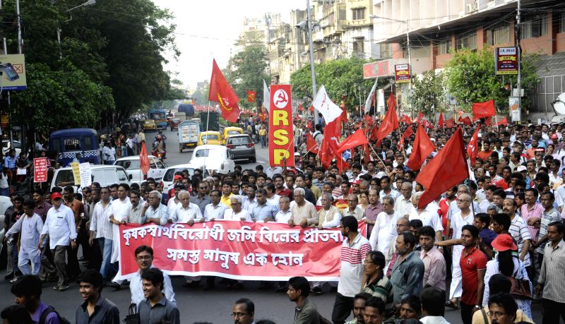 The members of Left Front led by chairman Biman Bose stage a demonstration against the land acquisition law in Kolkata, on April 7, 2015. - Biman Bose