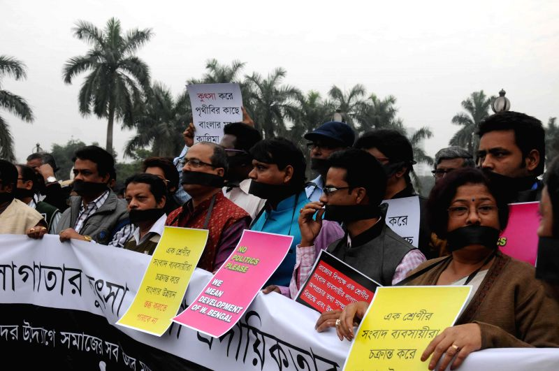 The members of Social Media Users of West Bengal participate in a silent protest against the recent arrests made by the CBI in connection with Saradha Chit Fund scam in Kolkata, on Dec 14, ..