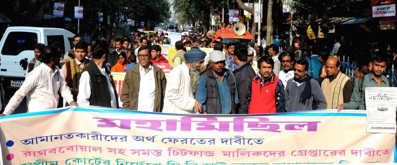 The members of the Chit Fund Sufferers Unity Forum participate in a rally to demand refund of their money in Kolkata on Dec 18, 2014.