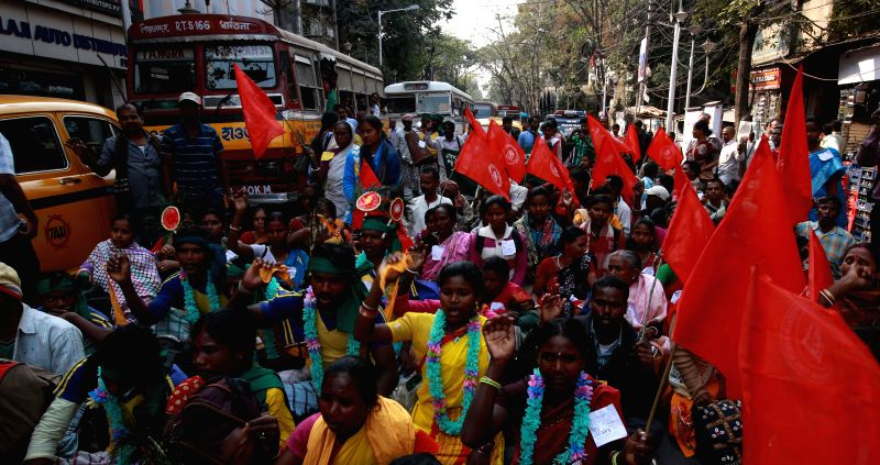 The members of West Bengal Khetmazdur Samity (WBKS) block roads to protest against the West Bengal Government at Kolkata on Feb 11, 2015.