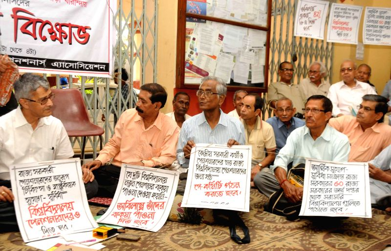 The members of West Bengal University Pensioners' Association ​participate in a protest against the state government in Kolkata, on Feb 25, 2015.