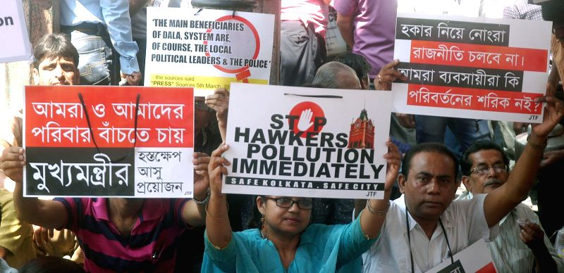 The shopkeepers of New Market area stage a demonstration against the hawkers on the second day of their strike in Kolkata, on March 12, 2015.