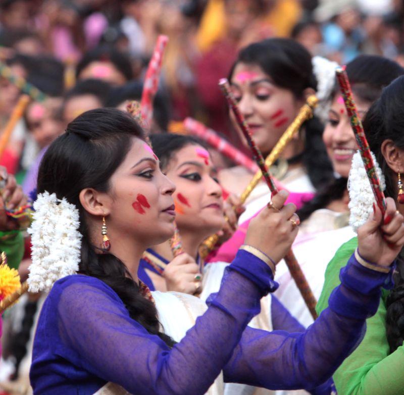 The students of Rabindra Bharati University celebrate holi at the Jorasanko Thakur Bari campus of the university in Kolkata, on March 2, 2015.