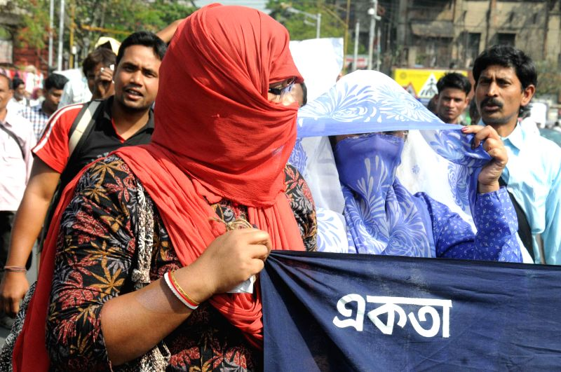 The trainers engaged in vocational training and adult education participate in a demonstration in Kolkata, on March 9, 2015.