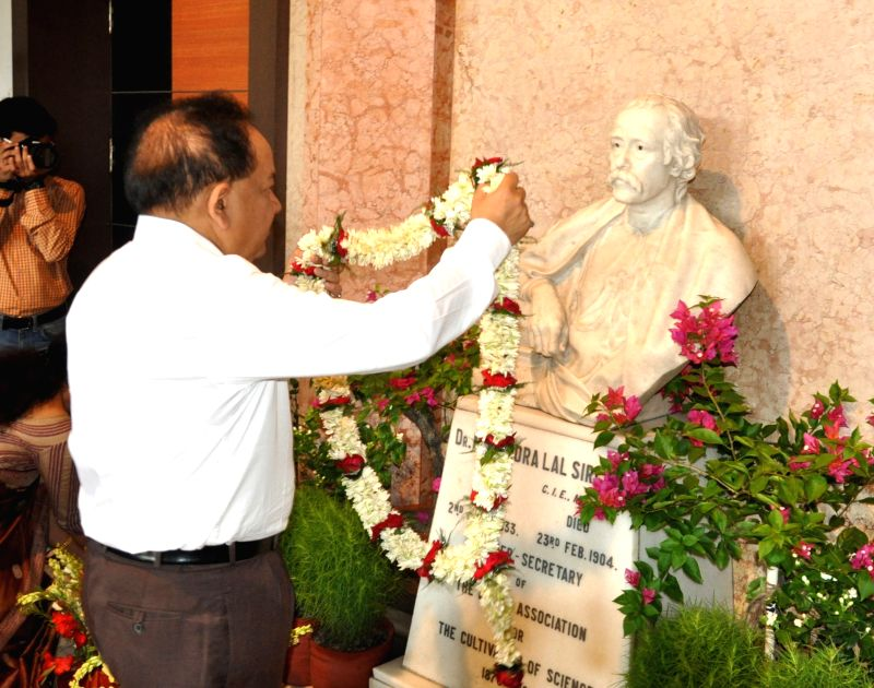The Union Minister for Science and Technology, and Earth Sciences, Dr. Harsh Vardhan garlands the founder, Dr. Mohendra Lal Sorcer's statue at the Indian Association for the Cultivation of ...