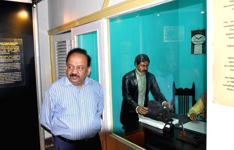 The Union Minister for Science & Technology and Earth Sciences, Dr. Harsh Vardhan in front of the replica of Acharya Jagadis Chandra Basu`s pioneering Microwave Experiment, at the ...