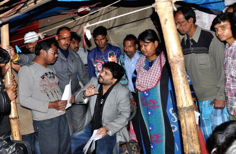 The Union Minister of State for Urban Development Babul Supriyo meets people living on the land marked for East-West Metro project in Kolkata, on Dec 30, 2014.