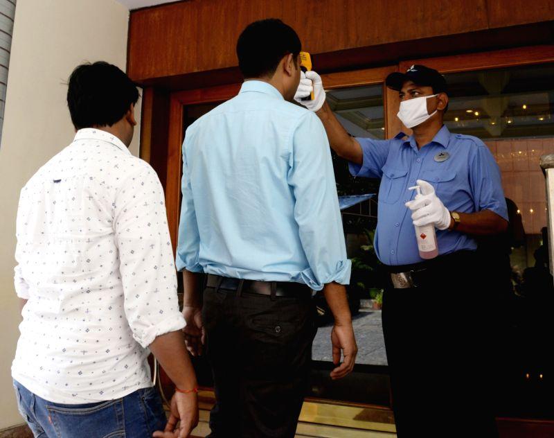 Kolkata: Thermal screening being conducted on visitors for COVID-19 amid coronavirus pandemic, at a hotel in Kolkata on March 18. 2002. (Photo: Kuntal Chakrabarty/IANS)