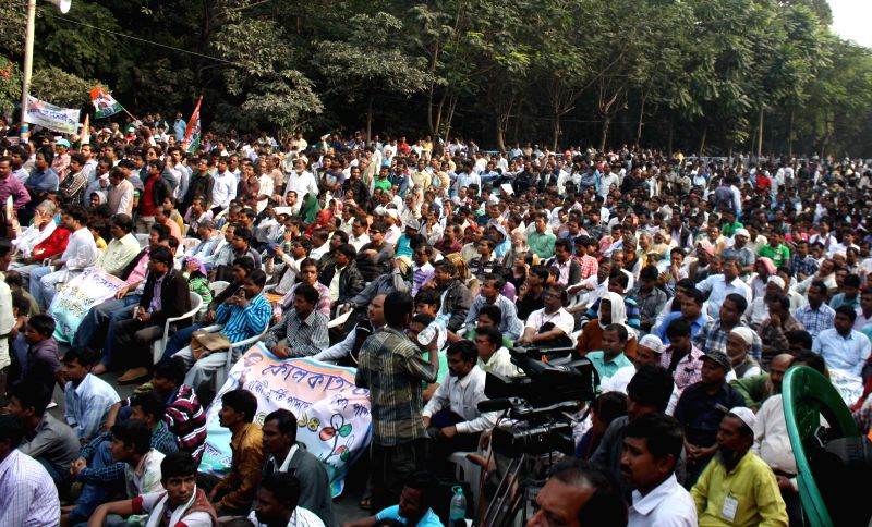 TMC activists take part during a rally to observe `Sanghati Diwas` or Integration Day in Kolkata  on Dec. 6, 2014.