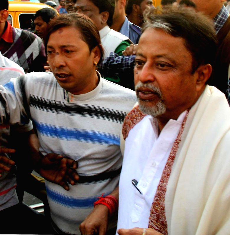 TMC MP Mukul Roy at West Bengal Chief Minister Mamata Banerjee's residence in Kolkata on Jan 31, 2015. - Mamata Banerjee