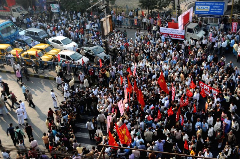 Traffic comes to a halt as left front workers participate in a rally against the Central Government in Kolkata, on Dec 11, 2014.