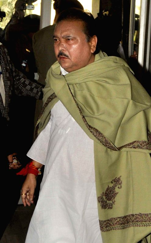 Trinamool Congress leader and West Bengal Transport Minister Madan Mitra arrives to appear before CBI in connection with the multi-crore-rupee Sardha chit fund scam in Kolkata on Dec 12, ...