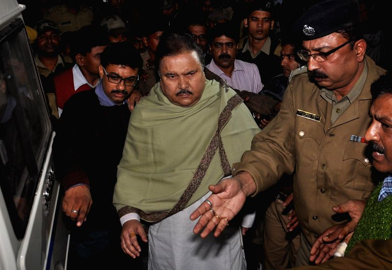 Trinamool Congress leader and West Bengal Transport Minister Madan Mitra, who was arrested by the CBI in connection with the multi-crore-rupee Sardha chit fund scam earlier today, being ...