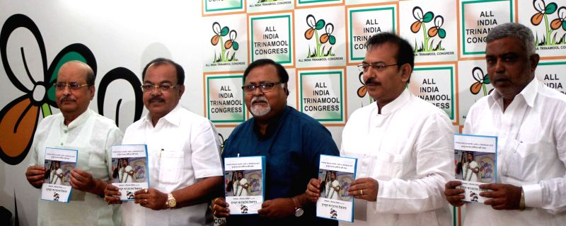 Trinamool Congress leaders Partha Chatterjee, Sovan Chatterjee, Sadhan Pande, Arup Biswas release party's manifesto for upcoming Kolkata Municipal Corporation polls in Kolkata, on March 30, ... - Partha Chatterjee and Sovan Chatterjee