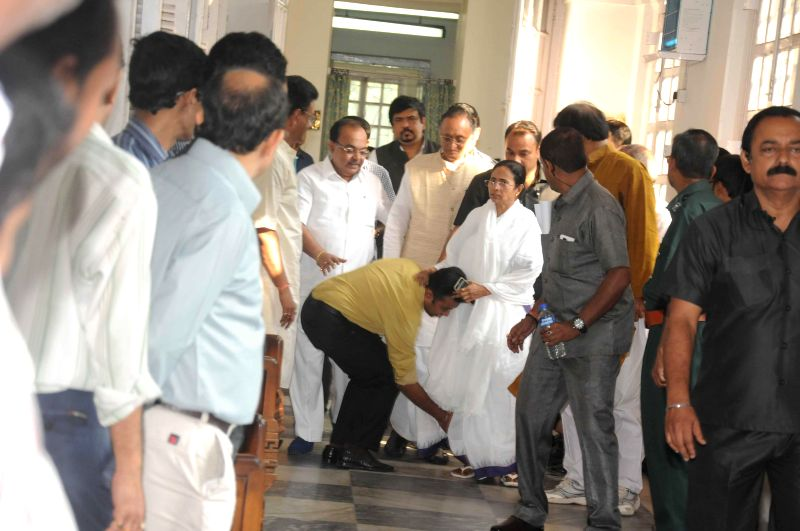 Trinamool Congress MP Mukul Roy's son Subhranshu Roy touches the feet of West Bengal Chief Minister Mamata Banerjee at the West Bengal Legislative Assembly in Kolkata, on Feb 27, 2015. - Mamata Banerjee, Mukul Roy and Subhranshu Roy