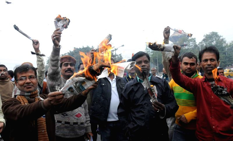 Trinamool Congress supporters protest against the proposed amendments to Land Acquisition Act in Kolkata, on Dec 31, 2014.