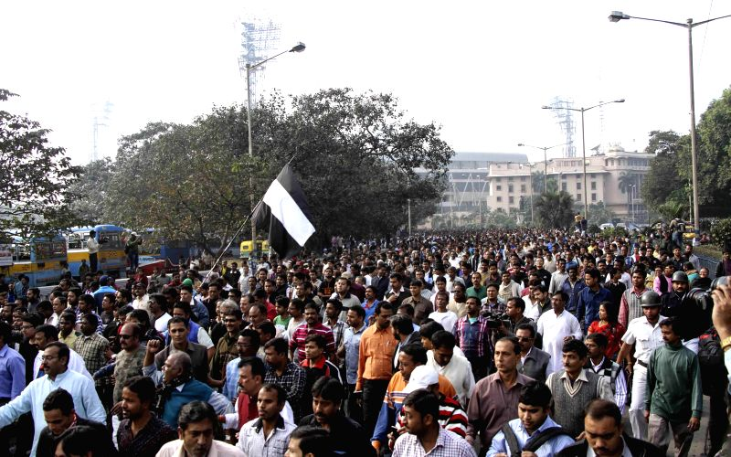Trinamool Congress (TMC) supporters participate in a protest rally against CBI in Kolkata on Dec. 13, 2014.