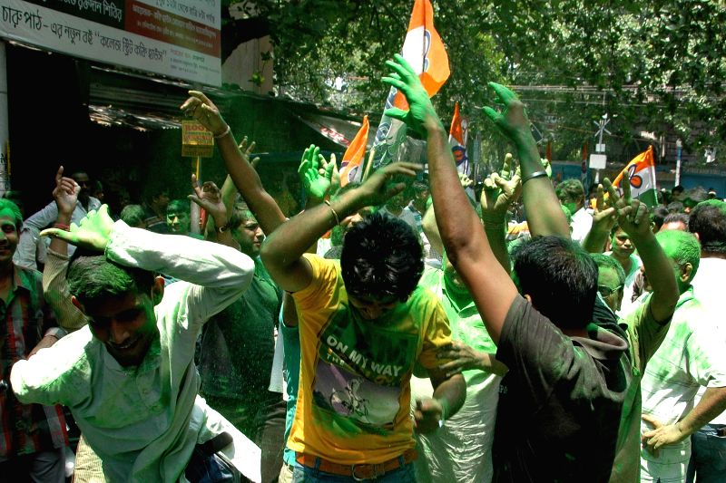 Trinamool Congress workers celebrate party's performance in the recently concluded West Bengal civic polls, in Kolkata, on April 28, 2015.
