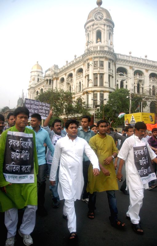 Trinamool Congress workers participate in a demonstration against the land acquisition law in Kolkata, on April 8, 2015.
