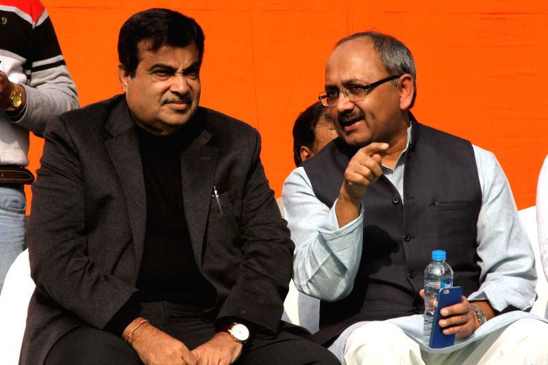 Union Minister for Road Transport and Highways, and Shipping, Nitin Gadkari interacts with West Bengal BJP Secretary Siddharth Nath Singh during `Modir Opoman Bharater Opoman` - a protest ... - Siddharth Nath Singh