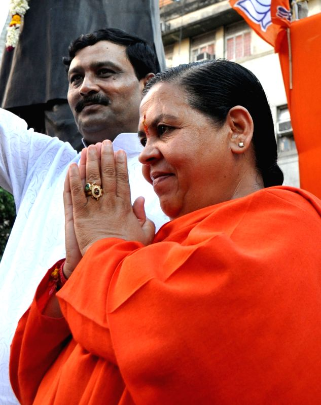: Kolkata: Union Minister of Water Resources, River Development and Ganga Rejuvenation Government of India, Uma Bharti and West Bengal BJP chief Rahul Sinha participate in a rally organised to ...