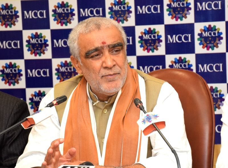 ": Kolkata: Union MoS Health and Family Welfare Ashwini Kumar Choubey during an interactive session on ""Health and Family Welfare: Recent Trends & Road Ahead"" at the Merchant Chamber of Commerce in ..."