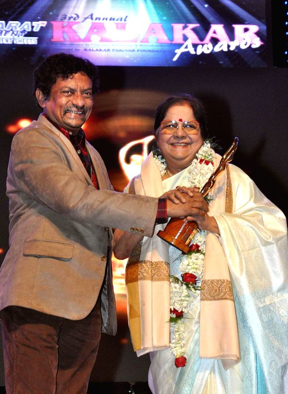Vetaran actress Lily Chakraborty receives Lifetime Achievement Award from filmmaker Goutam Ghosh during the 23rd Kalakar Awards in Kolkata on Jan 11, 2014. - Lily Chakraborty and Goutam Ghosh