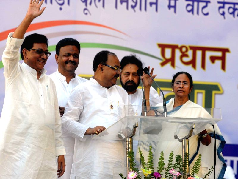 Veteran Congress leader Nirbed Roy joins Trinamool Congress in presence of West Bengal Chief Minister and TMC supremo Mamata Banerjee during a programme in Kolkata on April 10, 2015. Also ... - Mamata Banerjee