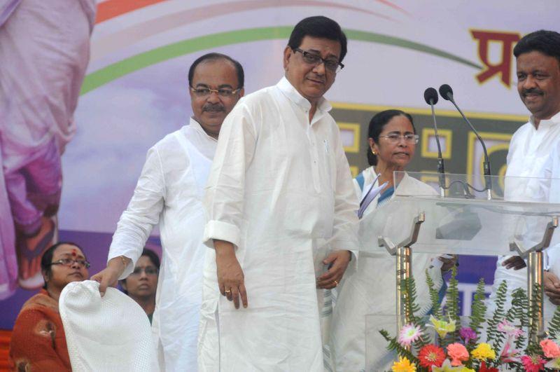 Veteran Congress leader Nirbed Roy joins Trinamool Congress in presence of West Bengal Chief Minister and TMC supremo Mamata Banerjee during a programme in Kolkata on April 10, 2015. - Mamata Banerjee