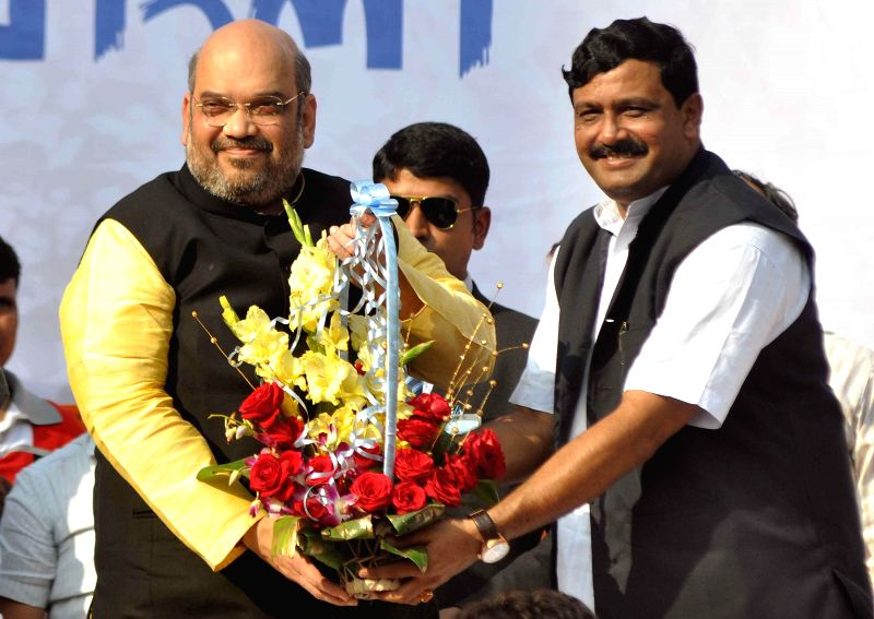 West Bengal BJP chief Rahul Sinha welcomes BJP chief Amit Shah during a party rally in Kolkata, on Nov 30, 2014. - Rahul Sinha