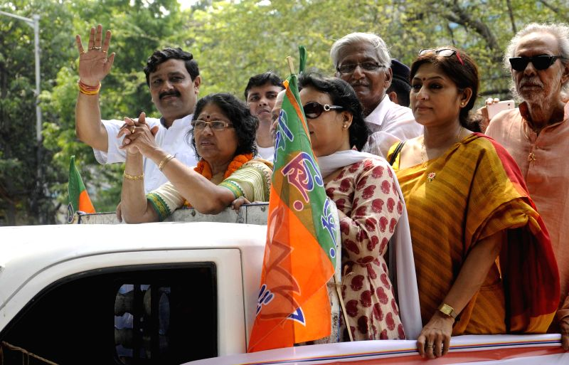 West Bengal BJP chief Rahul Sinha, actress Roopa Ganguly and other party leaders during an election campaign ahead of Kolkata Municipal Corporation polls in Kolkata, on April 5, 2015. - Roopa Ganguly and Rahul Sinha