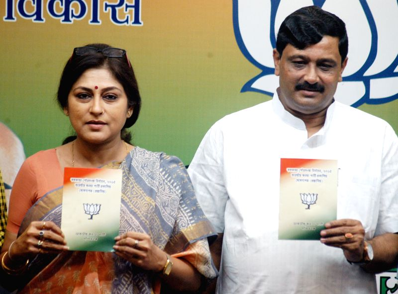 West Bengal BJP chief Rahul Sinha, party leader and actress Roopa Ganguly release party's manifesto for upcoming KMC polls during a press conference in Kolkata, on April 9, 2015. - Roopa Ganguly and Rahul Sinha
