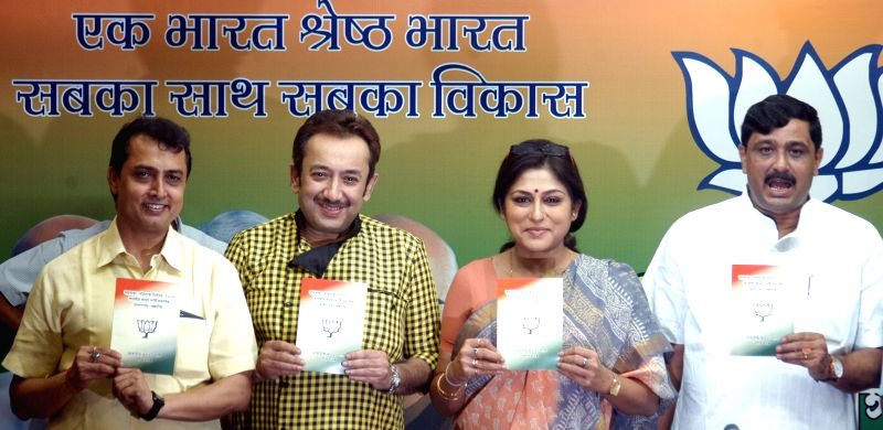 West Bengal BJP chief Rahul Sinha, party leader and actress Roopa Ganguly,  release party's manifesto for upcoming KMC polls during a press conference in Kolkata, on April 9, 2015. - Roopa Ganguly and Rahul Sinha