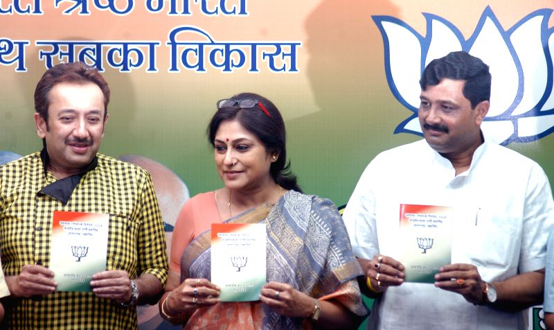 West Bengal BJP chief Rahul Sinha, party leader and actress Roopa Ganguly and others release party's manifesto for upcoming KMC polls during a press conference in Kolkata, on April 9, 2015. - Roopa Ganguly and Rahul Sinha