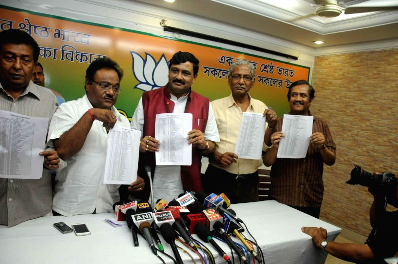 West Bengal BJP chief Rahul Sinha with other leaders announce the first list of candidates contesting Kolkata Municipal Electiona during a press conference in Kolkata on March 17, 2015. - Rahul Sinha