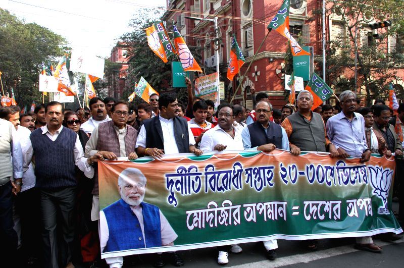 West Bengal BJP Secretary Siddharth Nath Singh and West Bengal BJP chief Rahul Sinha participate in `Modir Opoman Bharater Opoman` - a protest rally against West Bengal Government in Kolkata - Siddharth Nath Singh and Rahul Sinha
