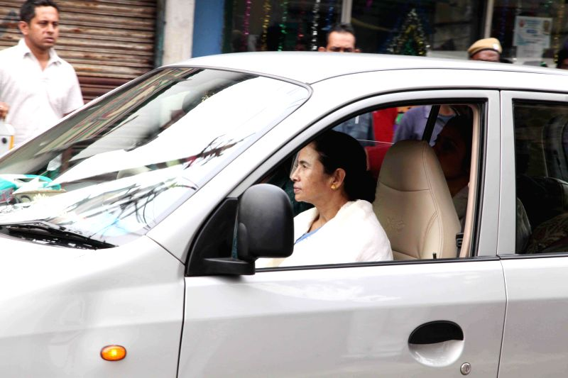 West Bengal Chief Minister and Trinamool congress supremo Mamata Banerjee comes out of her residence after a party meeting in Kolkata, on Jan 16, 2015.